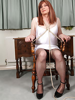 Lucimay strips down to her peticoat and then gets tied to a chair and teased.