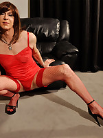 Sexy TGirl Emily is wearing a cheeky red lingerie out and black high heels.